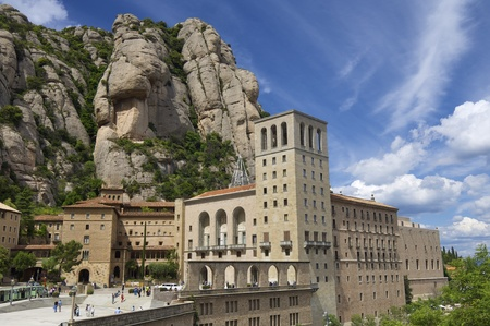 annually: Monistrol de Montserrat, Spain - June 6, 2009: Benedictine monastery of Montserrat symbol of the Spanish region of Catalonia receives annually visited by thousands of pilgrims and tourists