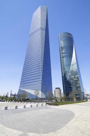 Madrid, Spain - July 29, 2009: Cuatro Torres Business Area next to the Paseo de la Castellana. To the left of the Glass Tower designed by architect Cesar Pelli Tower and right Space Tower designed by architect Henry N. Cobb. Stock Photo - 13204128
