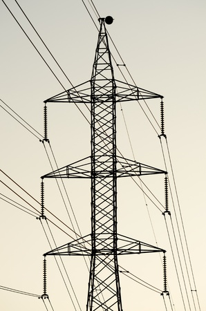 silhouette of  a high voltage tower photo