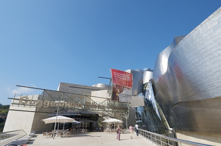Bilbao, Spain - July 30, 2011: view of the main entrance of the  Guggenheim Museum. Guggenheim Museum is dedicated  exhibition of modern art and was  designed by architect Frank Gehry. Stock Photo - 13204131