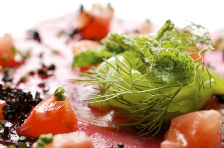 forefront: forefront of carpaccio of tuna  with diced tomatoes