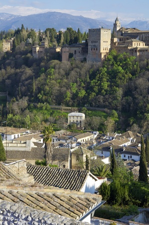 famous view of the Alhambra in Granada, the bottom of the image shows the mountains of Sierra Nevada, Andalusia, Spain photo