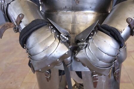 forefront: forefront of the hands of medieval armor Stock Photo