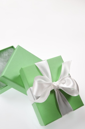 two small green box tied with a white ribbon photo