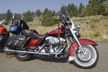 Yellowstone, Usa - August 16, 2007: Harley Davidson motorcycle parked on the side of the road. Used by thousands of motorists throughout the world, these bikes are a symbol of freedom and the United States of America.