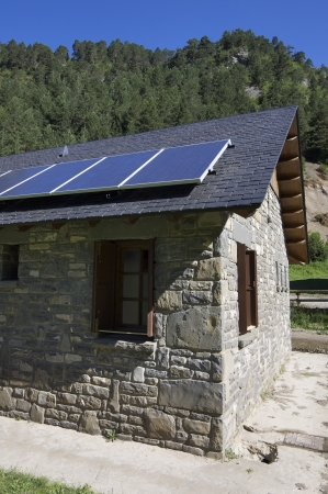 solar panels on a roof of stone slate, Bujaruelo Valley, Pyrenees, Huesca, Aragon, Spain