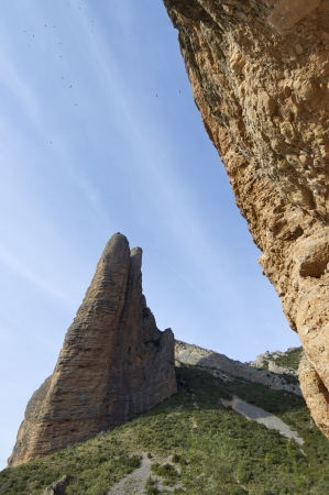 Fire Mallo in Riglos mountains and vultures flying, Huesca, Aragon, Spain Stock Photo - 14135397