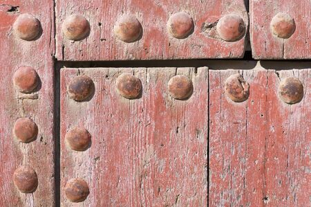 foreground of an old wooden red door Stock Photo - 14007326