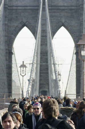 agglomeration: New York, Usa - December 28, 2007: agglomeration of tourists on the Brooklyn Bridge. crosses this bridge is one of the favorite activities of tourists when they visit the city of New York. Editorial
