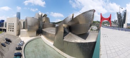 frank gehry: Bilbao, Spain, July 30, 2011: view of the  Guggenheim Museum. Guggenheim Museum is dedicated  exhibition of modern art and was  designed by architect Frank Gehry. Background at left is the Iberdrola Tower Bridge and right called Princes of Spain