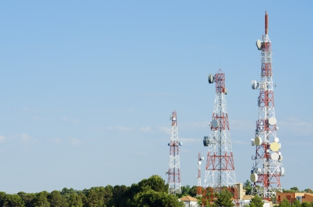 bottom view of  a telecommunications towers with a blue sky, La Muela, Saragosa, Aragon, Spain Stock Photo - 14102711