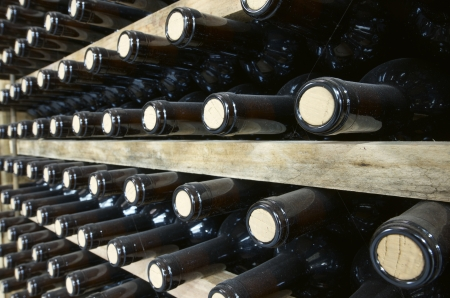 stacked wine bottles to ferment the wine, La Rioja, Spain Stock Photo
