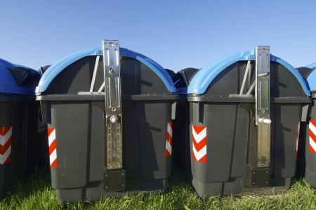 recycling bins for paper with blue sky photo