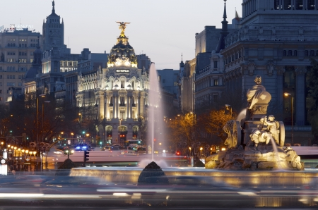 Madrid, Spain - March 22, 2012: heavy traffic in the historic center of Madrid, highlights the Metropolis building and the Cibeles fountain, two of the most visited monuments in the city. Editoriali