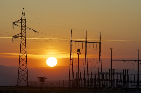 silhouette of a alectrical substation and setting sun, La Muela, Zaragoza, Aragon, Spain photo