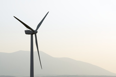 silhouette of a windmill for renewable electric energy production, Fuendejalon, Zaragoza, Aragon, Spain photo