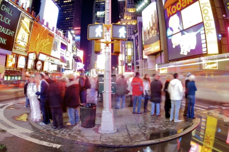 New York, Usa - January 2, 2008: New Yorkers and tourists strolling in Times Square with its bustle and its huge illuminated advertising signs is one of the most frequented places in New York.