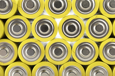 forefront of a group of yellow batteries photo