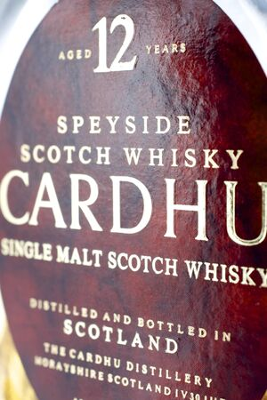 Zaragoza, Spain - December 11, 2011: forefront of the label of a bottle of Scotch brand Cardhu. Distillery Cardhu malt whiskey was founded in 1824 by the smuggler John Cumming and is highly regarded worldwide.