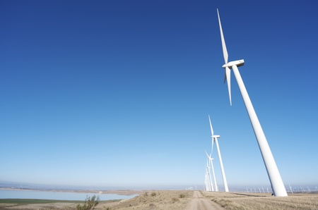 aligned windmills for renowable electric production, left the reservoir of La Loteta, Pozuelo de Aragon, Zaragoza, Spain photo