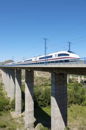 view of a high-speed train crossing a viaduct in Castejon de las Armas, Saragossa, Aragon, Spain; AVE Madrid Barcelona Editoriali