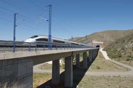 view of a high-speed train crossing a viaduct in Bubierca, Saragossa, Aragon, Spain; AVE Madrid Barcelona