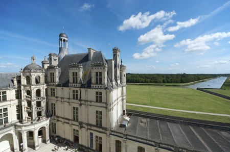 Chambord, France - August 16, 2012: Tourists walk in Chambord Castle. Built as a hunting lodge for King Francois I, between 1519 and 1539, this castle is the largest and most frequented of the Loire Valley.