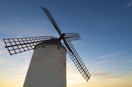 sunset at  the windmills of Consuegra, Toledo, Castilla La Mancha, Spain photo