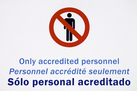 authorized: authorized personnel only sign, in English, French and Spanish