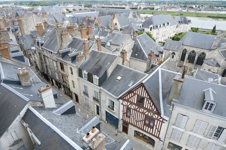 forefront of roofs in the old city of Blois, Loire Valley, France photo