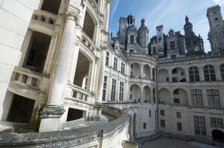 Chambord, France - August 16, 2012: Tourists visit Chambord Castle. Built as a hunting lodge for King Francois I, between 1519 and 1539, this castle is the largest and most frequented of the Loire Valley.