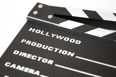 Detail of a clapperboard with white background photo