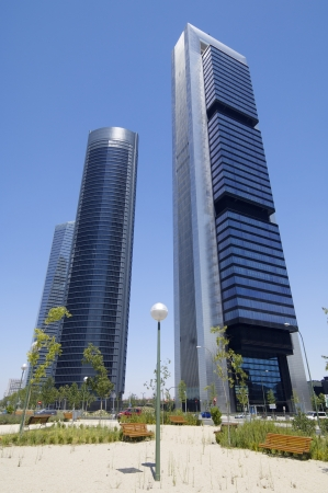 tallest: Madrid, Spain - July 29, 2009: Cuatro Torres Business Area next to the Paseo de la Castellana. To the right Bankia Tower designed by Norman Foster, to the left PwC Tower, designed by architects Rubio Carvajal and Alvarez-Sala, and bottom Glass Tower desig