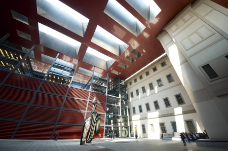 edifice: Madrid, Spain - March 22, 2012: tourists visit Nouvel Edifice in the museum Reina Sofia. This museum  is dedicated to the exhibition of modern and contemporary art and is one of the most visited in the city of Madrid Editorial