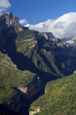 snowy mountains and forested gorges Anisclo Valley, Ordesa National Park, Pyrenees, Huesca, Aragon, Spain photo