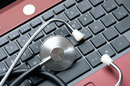 close up of a stethoscope and a computer keyboard photo