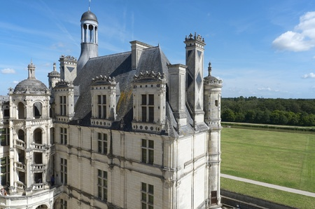 frequented: Chambord, France - August 16, 2012: Tourists walk in Chambord Castle. Built as a hunting lodge for King Francois I, between 1519 and 1539, this castle is the largest and most frequented of the Loire Valley.
