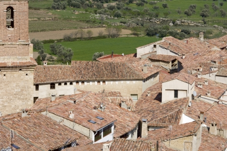 view from above the tiled roofs of a Spanish village, Cuevas de Canart, Teruel, Aragon, Spain photo