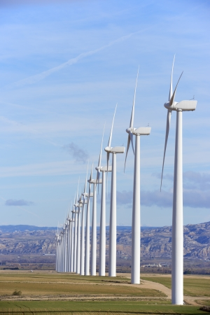 aligned windmills for renewable electric energy production Stock Photo