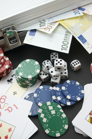 background gambling with euro banknotes, casino chips, cards and dices Stock Photo - 17707171