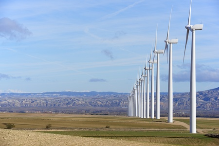 wind energy: aligned windmills for renewable electric energy production Stock Photo