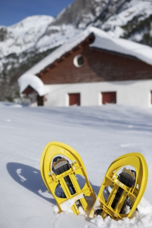 snowshoes: Yellow snowshoes in Canfranc Valley, Pyrenees, Huesca, Aragon, Spain Stock Photo