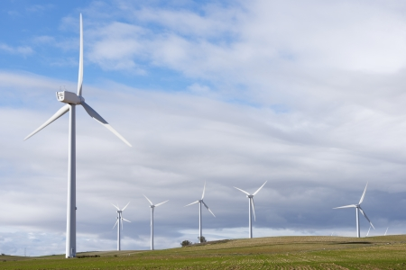 windturbine: aligned windmills for renewable electric energy production Stock Photo
