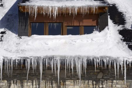 Icicles on the roof of a house in the Pyrenees, Canfranc Valley, Huesca, Aragon, Spain. photo