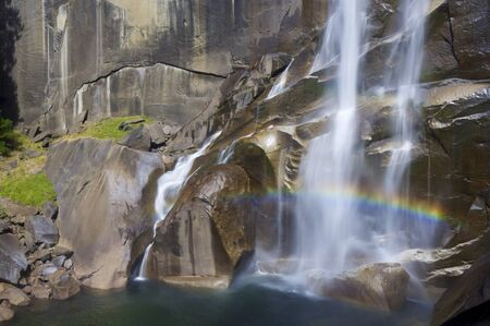 Waterfall known as Vernal Fall falling on a smooth wall of granite in Yosemite National Park, California, USA photo