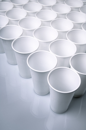large group of white disposable plastic cups photo