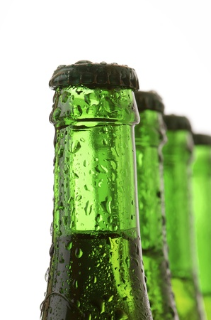 forefront of  a green bottles of beer photo