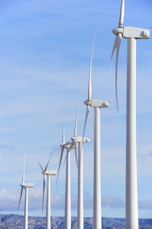 electric energy: aligned windmills for renewable electric energy production Stock Photo