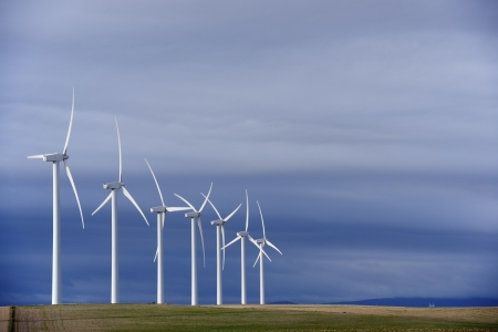 group of windmills for renewable electric energy production photo