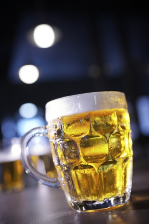 closeup of a beer mug in a bar photo